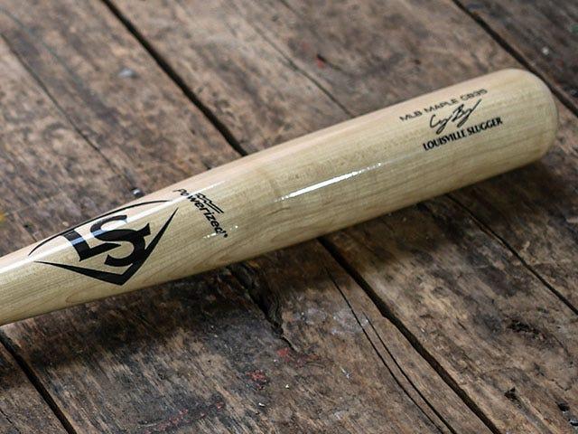 CB35 Signature bat on wooden surface
