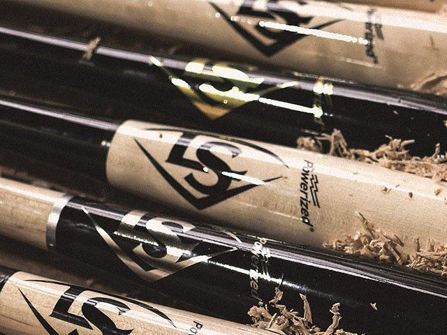Close up of baseball bats with LS logo